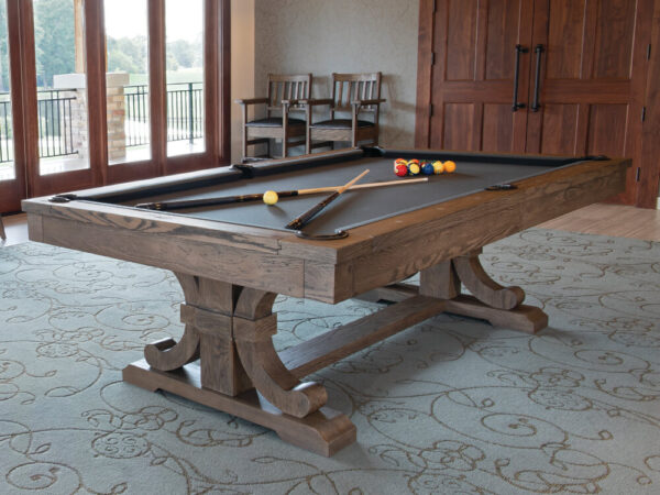 table with pool cues on it in a carmel color