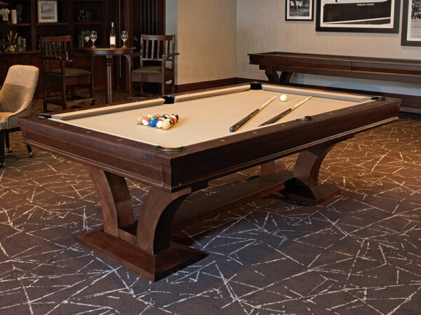 room setting featuring pool table with billiards accessories on its playing surface