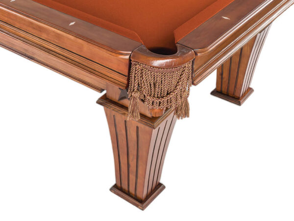 Close up image of pool table leg in brown and star on it's side